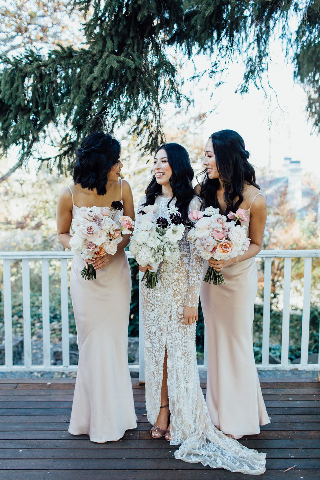 Bridesmaids with bouquets at Centennial vineyards wedding
