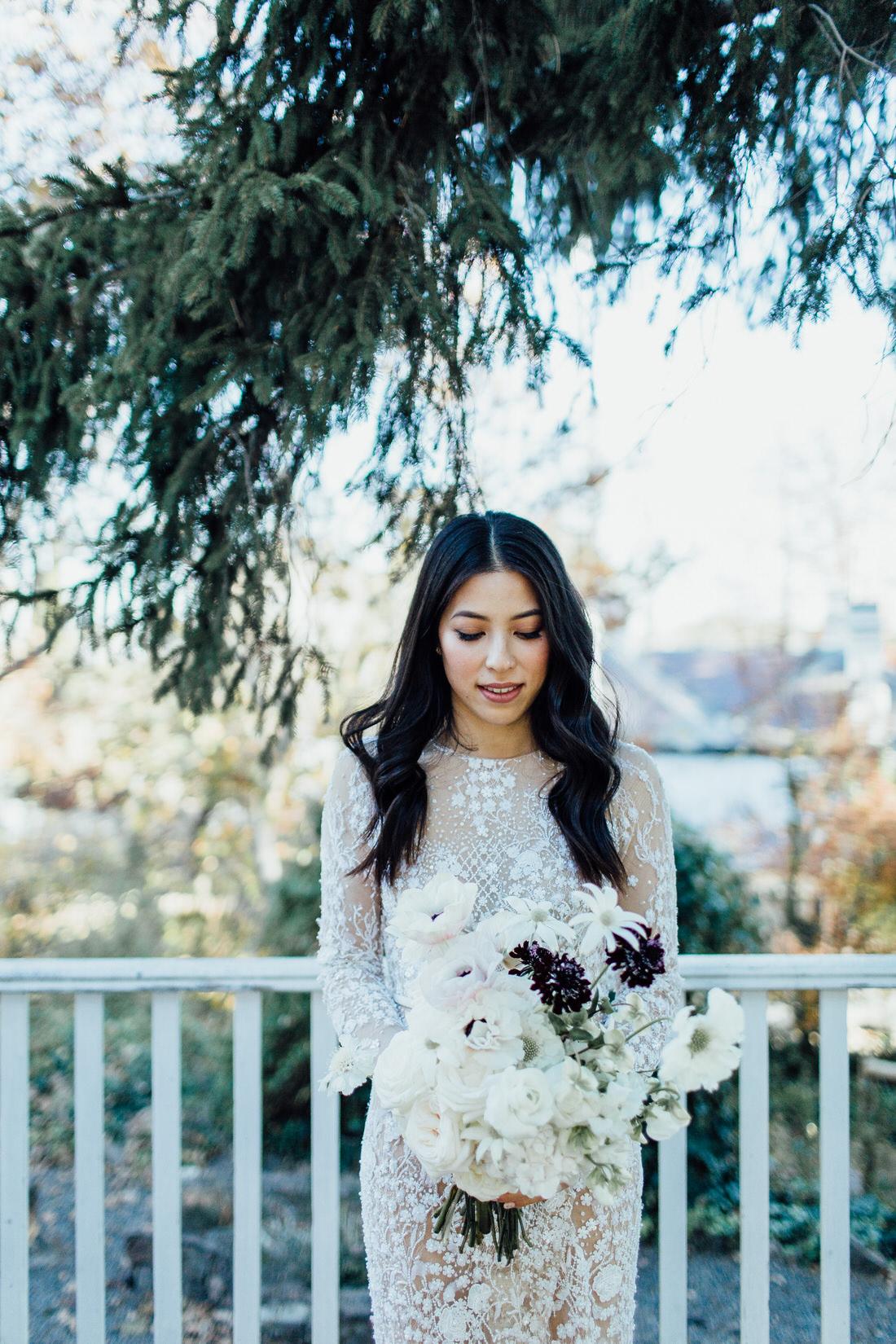 Modern Jane Hill bride with bouquet at Centennial vineyards wedding