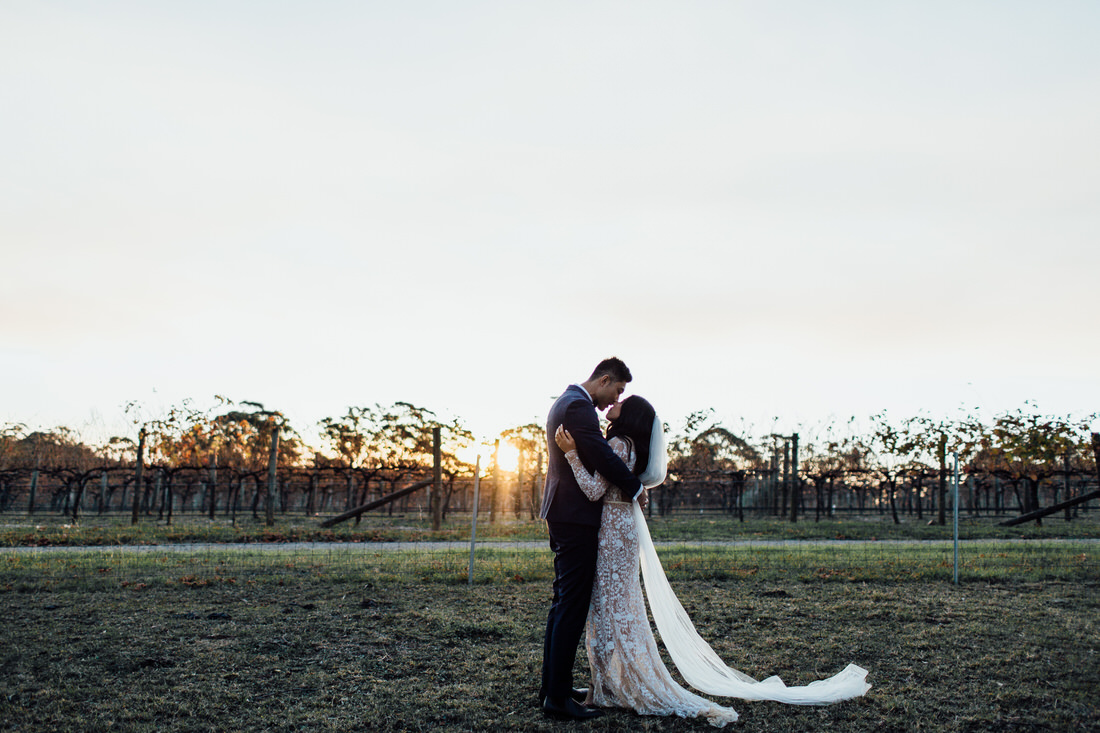 Centennial Vineyards wedding with bride and groom at sunset